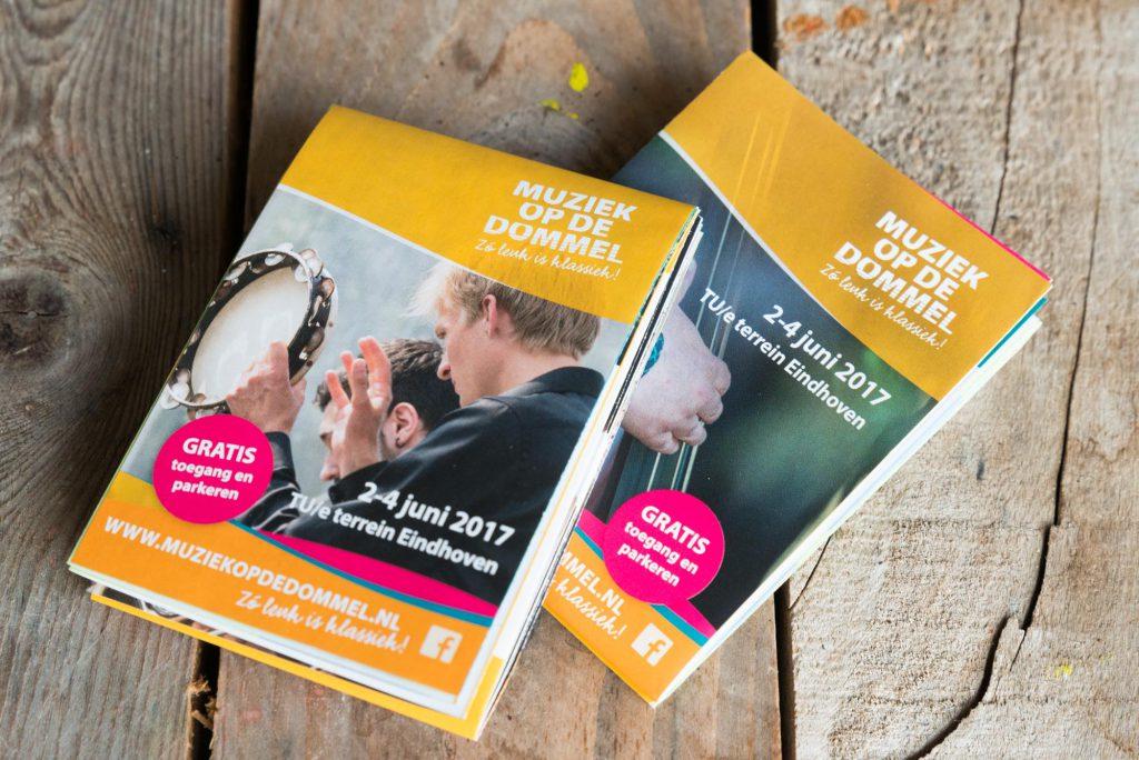 Tot A6 gevouwen folder met heel veel informatie over het programma van Muziek op de Dommel.